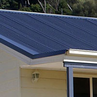KIT HOME ROOFING: Your choice of colour in corrugated iron. 					 					Colorbond gutters and downpipes to floor level. 					 					Antiglare aluminium thermofoil sarking to walls and roof. 					 					All hardware including brackets, silicone, rivets, etc.