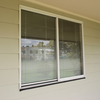 KIT HOME WINDOWS: Aluminium sliding windows in a variety of colours. 					 					Flyscreens to all windows 					 					Keyed alike locks fitted to all windows.